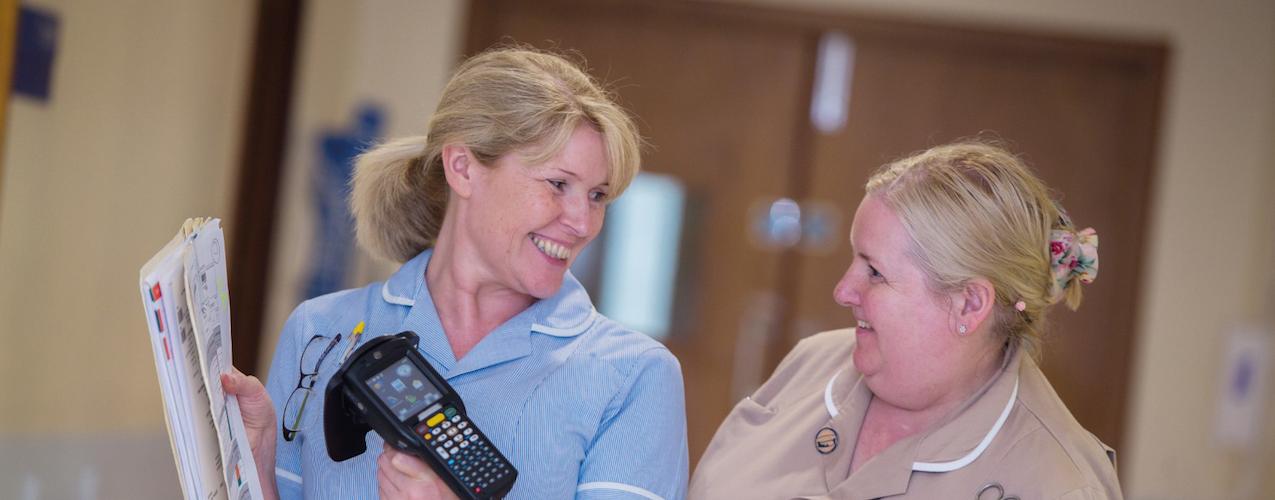 Nursing staff scanning assets with mobile device