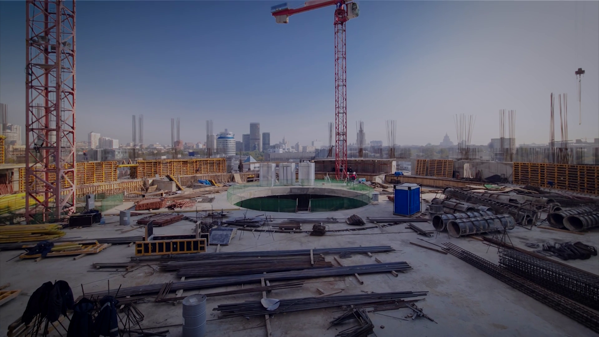 Large scale construction site overlooking the city skyline